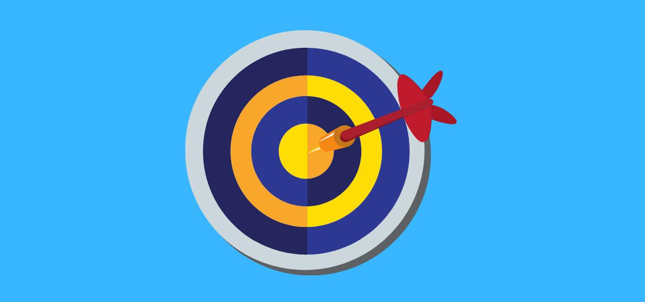Dartpil som treffer bullseye