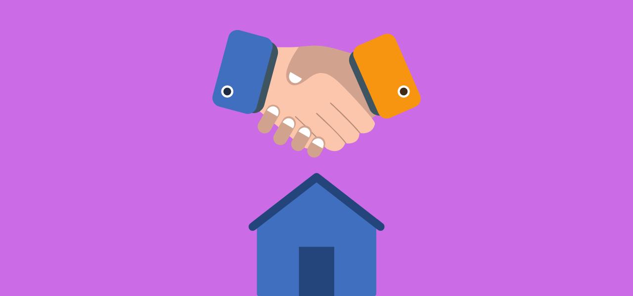 Boligselger håndhilser på boligkjøper